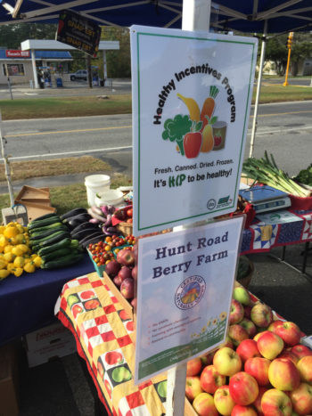 "A HIP sign at a Massachusetts farmers' market. (Photo courtesy of <a href=""https://www.mafoodsystem.org/news/archive/"">the Massachusetts Food System Collaborative</a>)"