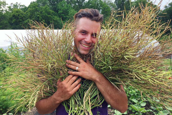 Owen Taylor with broccoli rabe. (Photo courtesy of Truelove Seeds)