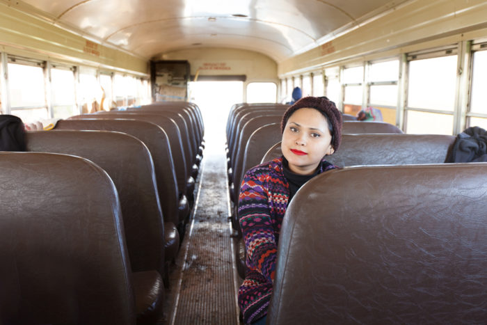 Blanca Lira Sanchez takes care of the bus that transports workers into the field, including emptying garbage and cleaning toilets. Photo © Scott Baxter.