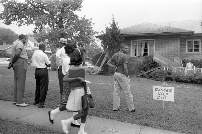 Group of African Americans viewing the bomb-damaged home of Arthur Shores, NAACP attorney, Birmingham, Alabama, the day after a bomb exploded on September 4, 1963. (Photo courtesy of the Library of Congress)