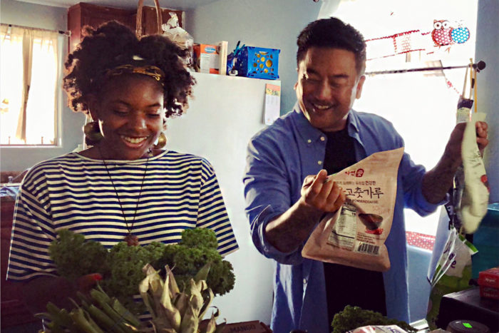 "Olympia Auset cooks with Roy Choi as part of Choi's ""Broken Bread"" television program."