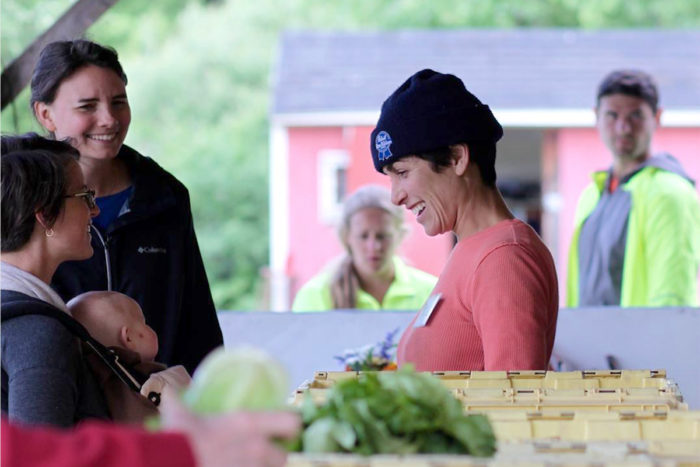 Filling veggie boxes at Intervale Community Farm. (Photo credit: Abby Portman)