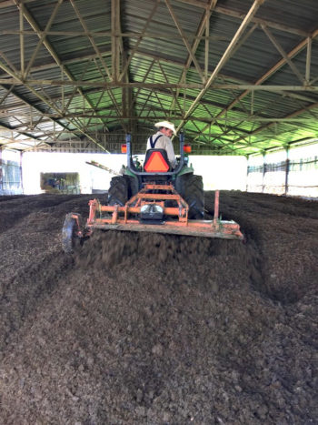 Farmer Garry Mahrt at Gillian's Dairy making compost. (Photo credit: CalCAN)