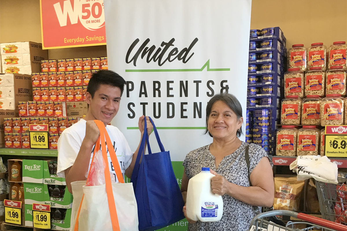 Shopping in the Inglewood Grocery Outlet after it was awarded the UPAS Store of Excellence Award. (Photo courtesy of UPAS)