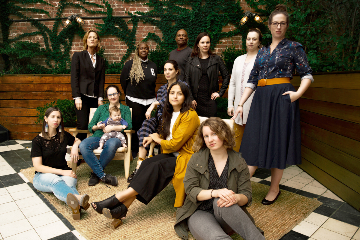 A portrait of the Working Parents team from the WIHU Spring. Included in the group are: Back row, from left: Susan Spikes, Suzanne Barr, Matt McFarlane; Kate Galassi: seated in green sweater, holding the baby. (Photo credit: Bridget Shevlin)
