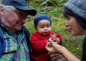 Baby Magnus gets a feed of siák̓vṇaɫ courtesy of his grandfather Larry and Jessie Housty.