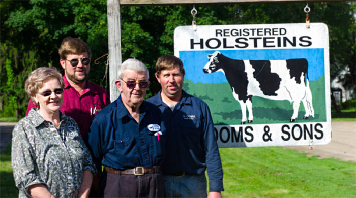 "The Ooms family. (Photo credit: <a href=""https://www.cabotcheese.coop/a.-ooms-sons-dairy-farm"">Cabot</a>)"" width=""700″ height=""390″></p> <p class="