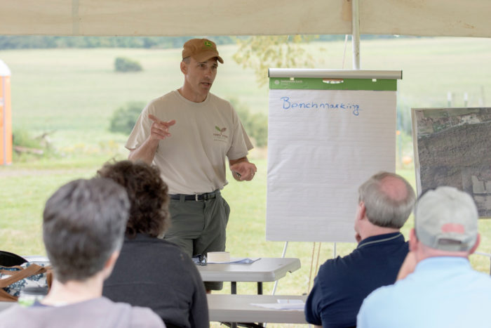 John Lemondes leading a discussion among farmer veterans. (Photo © James Bemus.)