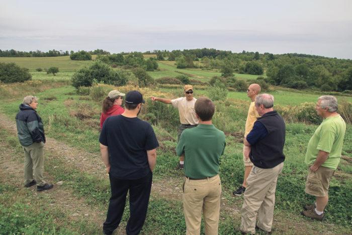 John Lemondes leading a farm tour for a group of farmer veterans. (Photo © James Bemus.)