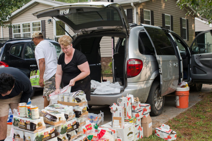 Melissa Bailey Castillo organizes an impromptu food donation drive to deliver to farmworker families in eastern North Carolina. Photo by Justin Cook.