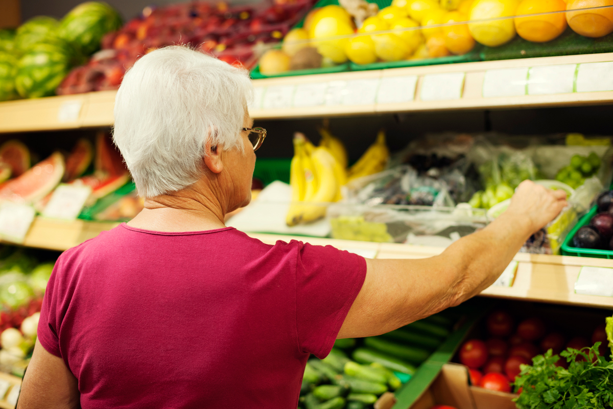 woman reaching for organic produce at the store