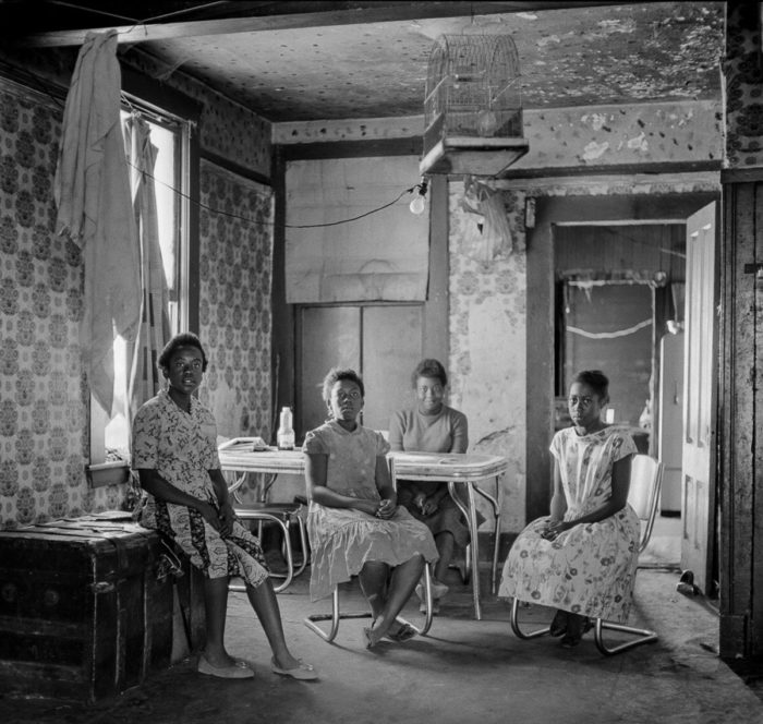 A Black family inside their home. Photo © Ernest Lowe
