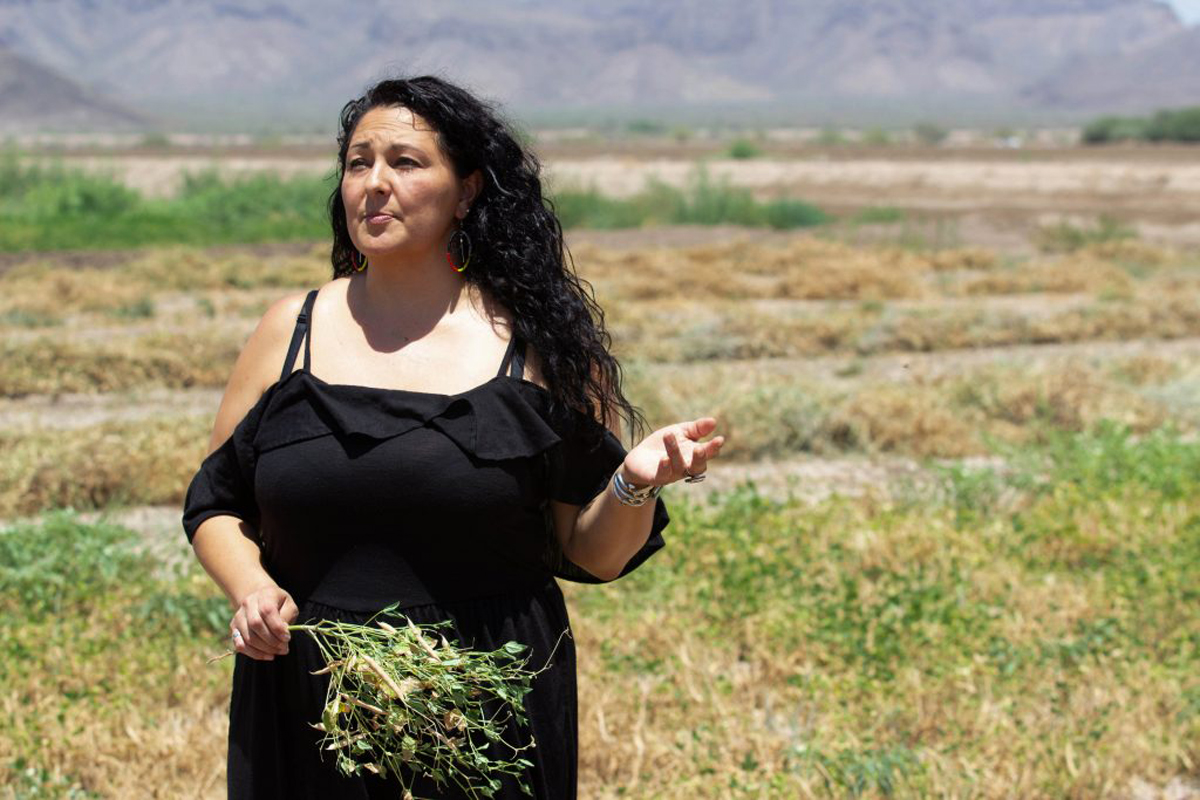 Velvet Button, spokeswoman for Ramona Farms and daughter of the owners, discusses how the tepary bean grows and is harvested. (Photo By Tayler Brown/Cronkite News)