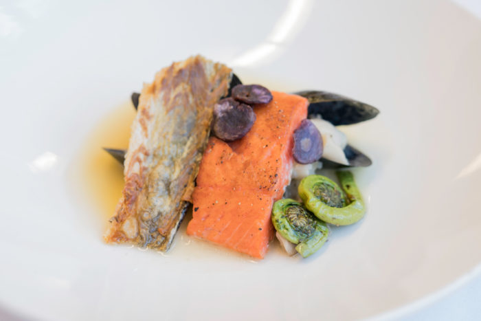 Nvni Homma Sholobachi Tuk (smoked salmon, mussels, foraged mushrooms, fiddlehead ferns, and potato crisps) from Reed's capstone meal. Photo © Katherine Kehrli.