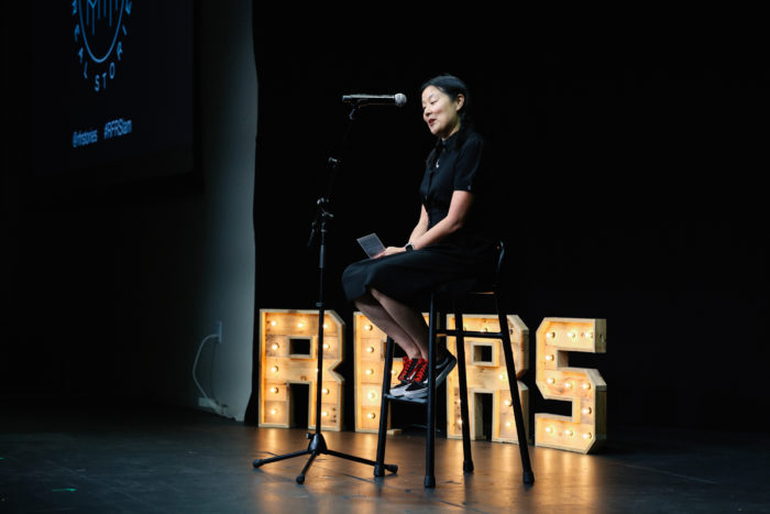 Michelle Tam presents at StorySlam 2018. (Photo © Kristen Murakoshi Photography)