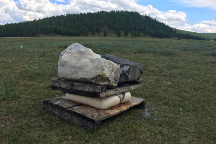 Pressing the cheese in a Mongolian field.