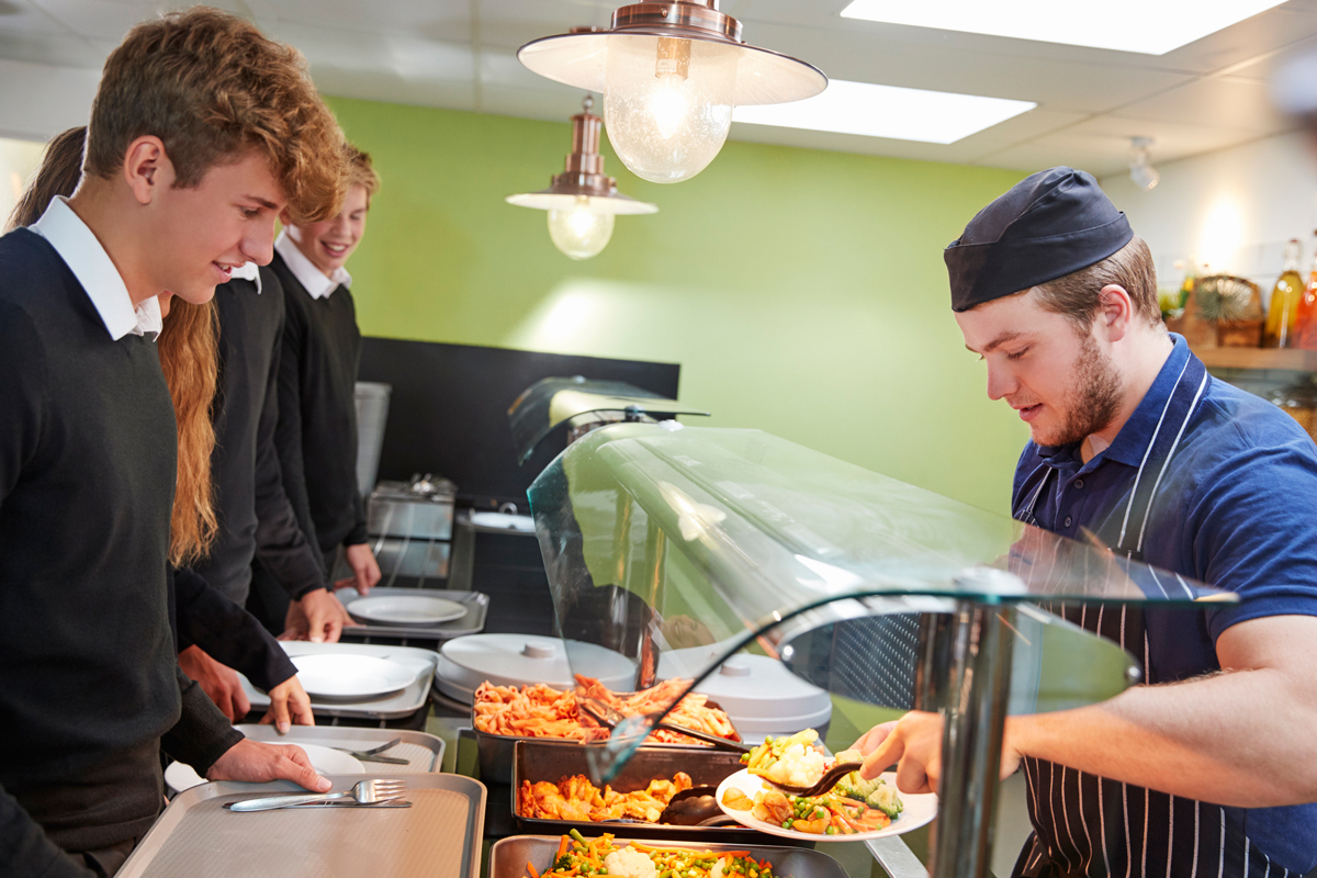students receiving school lunch in a cafeteria