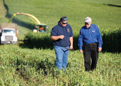North Dakota farmer Gabe Brown (left) discusses how he can improve soil health, a focal point of any climate risk management plan, with Jay Fuhrer of the USDA Natural Resources Conservation Service. (Photo by Scott Bauer)