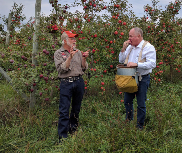 Michigan apple grower Jim Koan (left) explains his business strategies to former USDA Farm Service Agency Administrator Val Dolcini (right). Koan's cider operation provides consistent cash flow in years when weather disrupts apple production. (Photo by Savannah Halleaux, USDA)