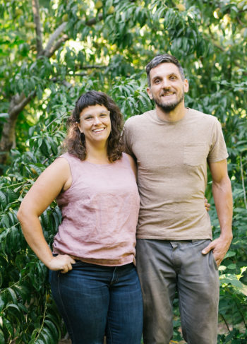 Bountiful Backyard founders Kate DeMayo and Keith Shaljian in front of their peach tree.
