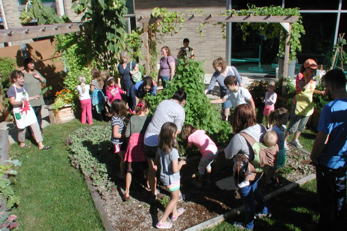 parents and children in an edible garden