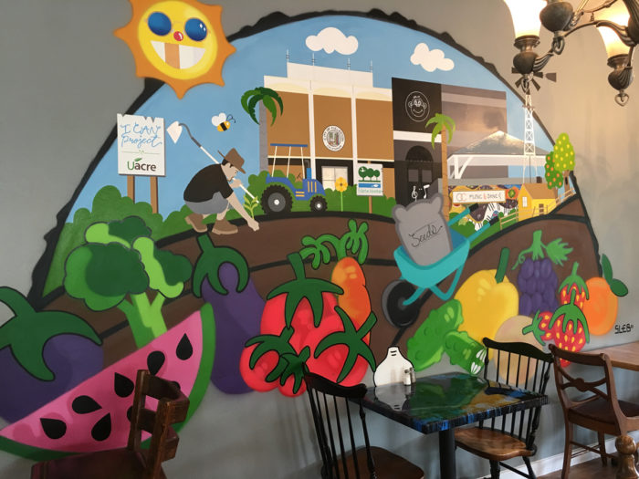 Oscar Maldonado's mural at the Monkey Business Café. (Photo credit: Sara Johnson)