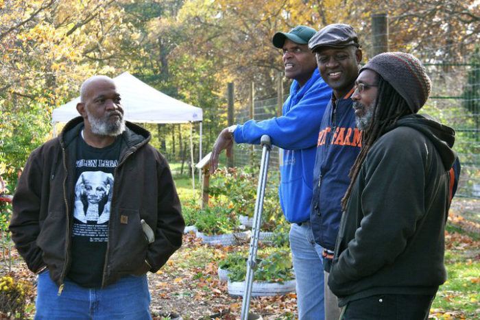 SAAFON ambassador Malik Yakini (right), with Growing Power's Will Allen (center) and others building a hoop house for a farm in Detroit. (Photo courtesy of SAAFON)