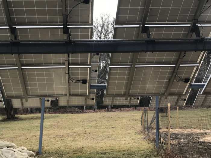 The underside of a dual-use solar array. The hardware used to mount the panels make it easy to reposition each panel to maximize the light needed to grow crops underneath.