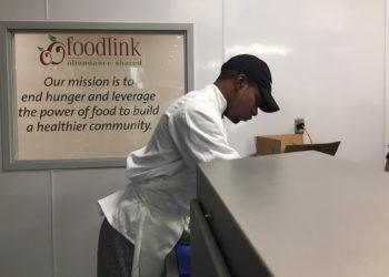 Jehmel Alexander working in the Foodlink kitchen.