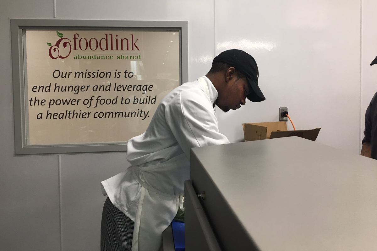 Jehmel Alexander working in the Foodlink kitchen.