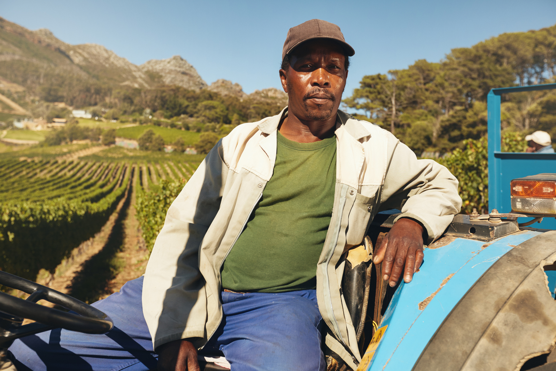 black farmer sitting on a tractor
