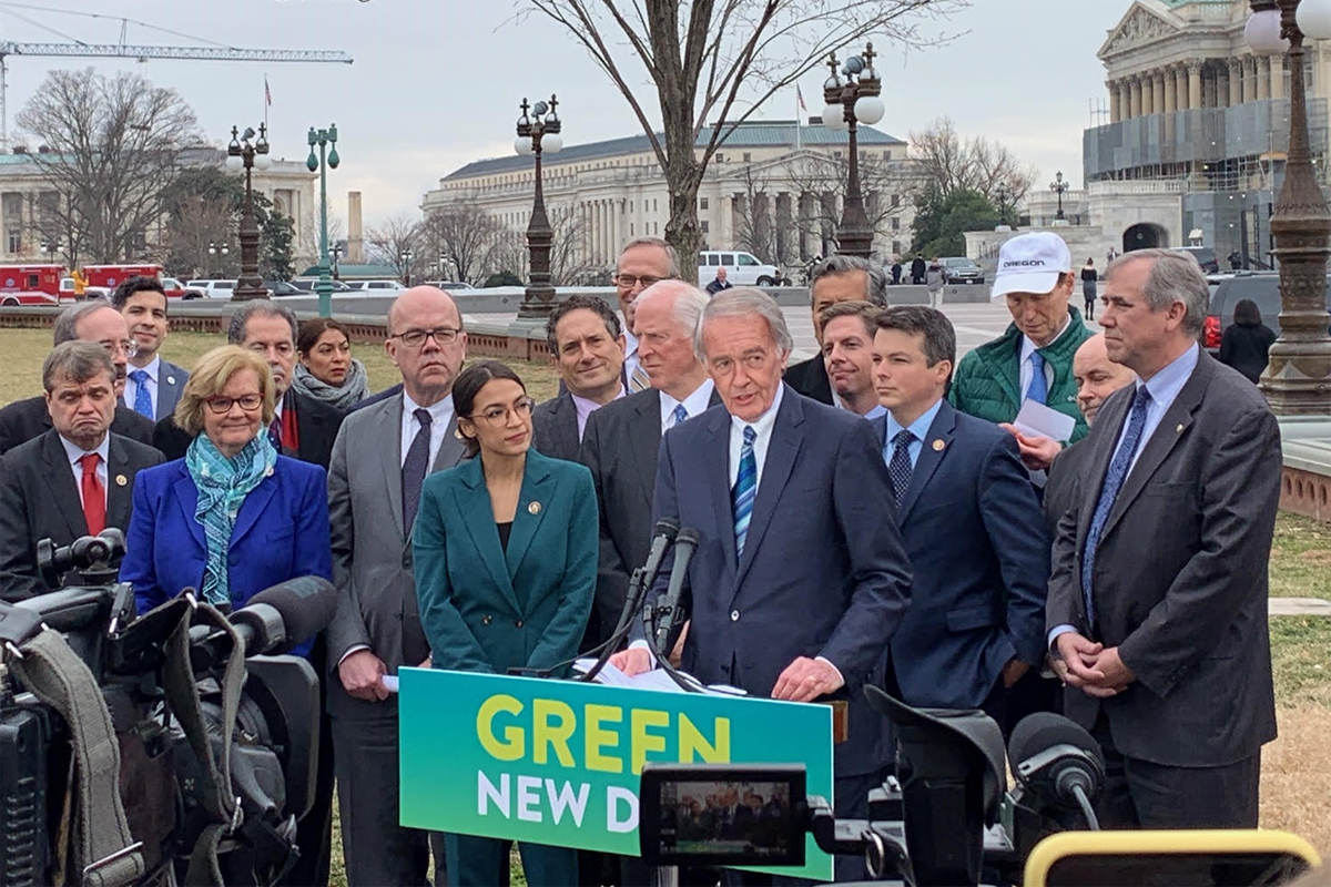 Rep. Alexandra Ocasio-Cortez and Sen. Ed Markey during the introduction of the Green New Deal resolutions.