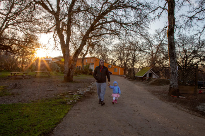 "Chad Eatinger takes his daughter for an early morning walk. The Eatinger family has made three overnight ""farmstays"" to Long Dream Farm."