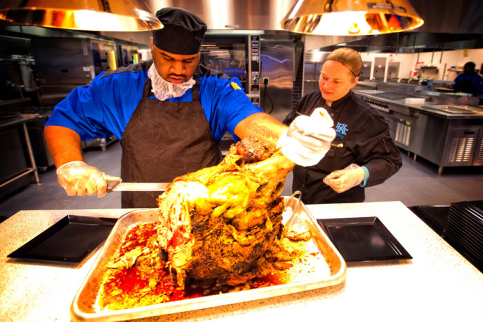 Production Chef Danielle Gallaway oversees the carving of a bison steamship from Floyds Fork Bison Farm in La Grange, KY. (Photo courtesy of University of Kentucky)