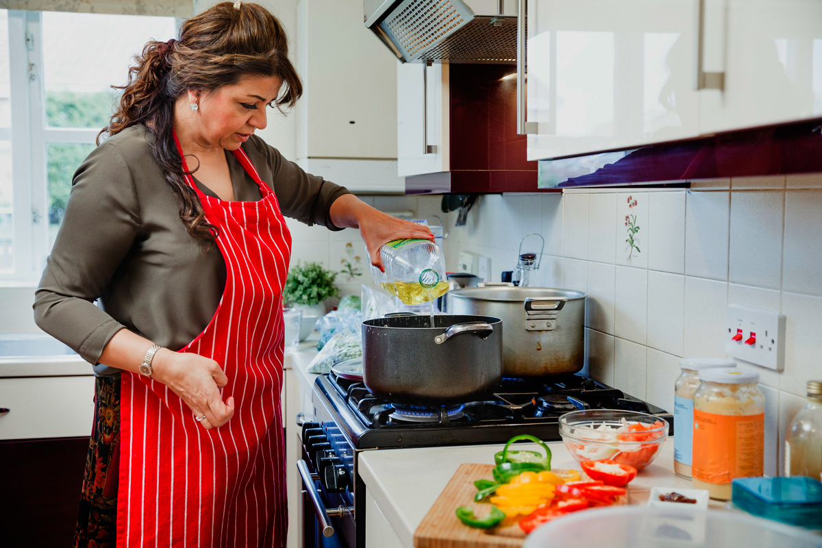 Image result for latina mother cooking with daughter