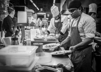 chefs working in a kitchen