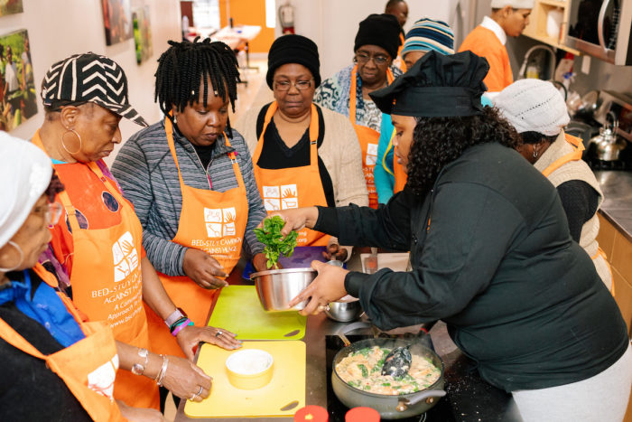 A cooking class at The Campaign Against Hunger