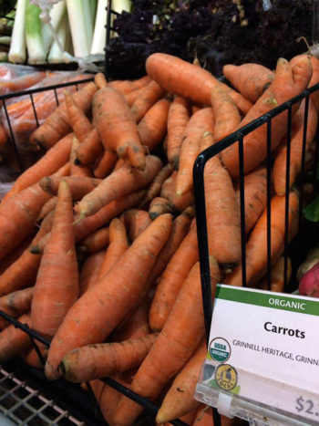 Grinnell Heritage Farm carrots for sale at New Pioneer Coop, Iowa City. (Photo courtesy of Grinnell Heritage Farm)