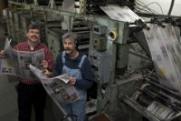 art cullen and his brother john at the newspaper printing press