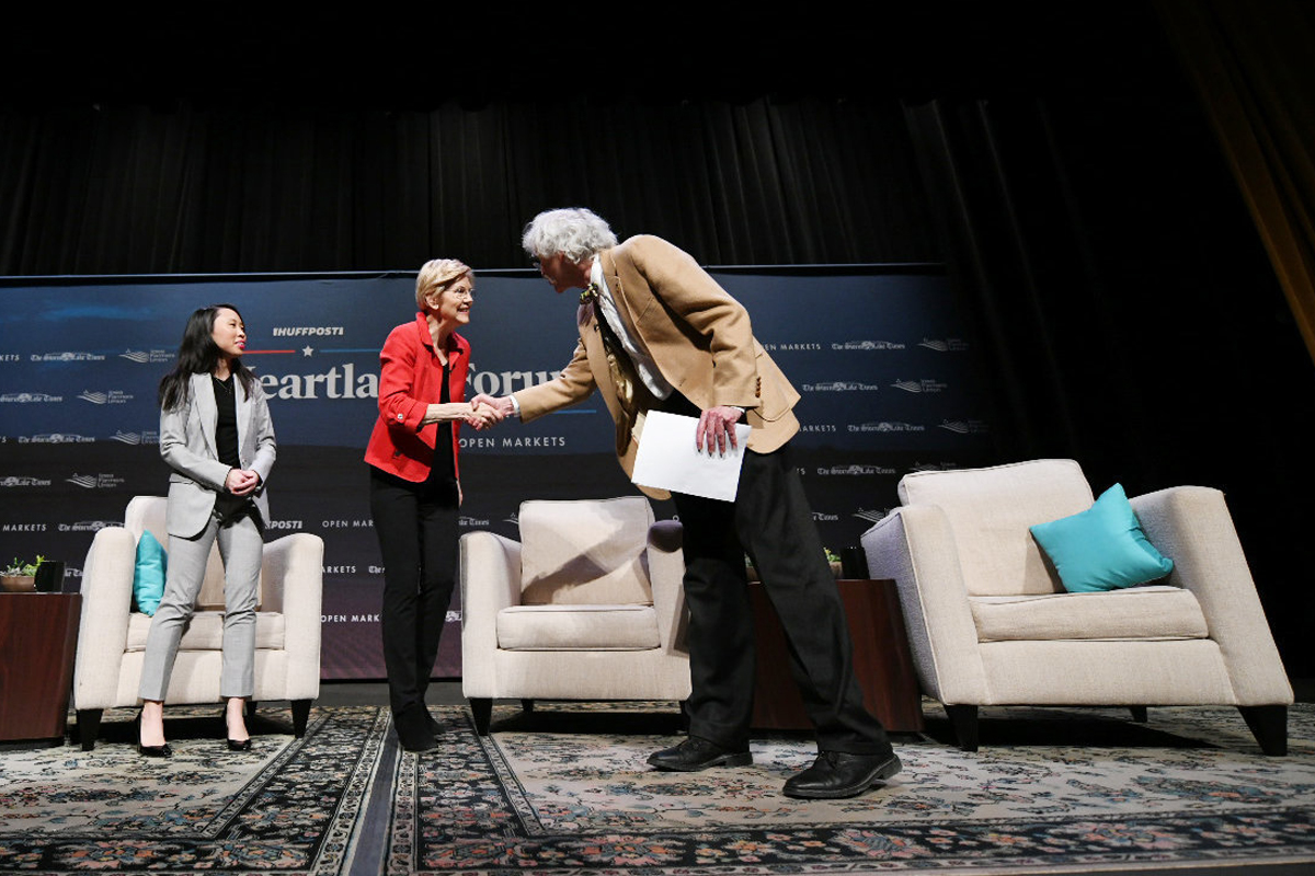 Senator Elizabeth Warren (center) greeted by Art Cullen at the Heartland Forum. (Photo © Damon Dahlen/HuffPost)