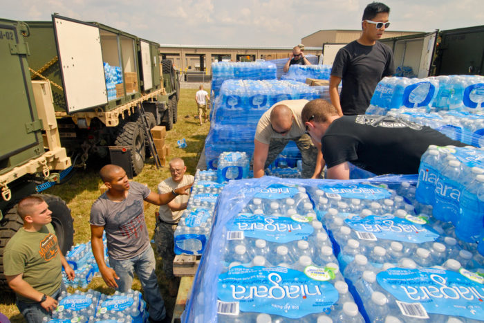Soldiers package bottled water for distribution sites throughout Toledo, Ohio, Aug.3, 2014. Ohio Air National Guard photo by Master Sgt. Beth Holliker