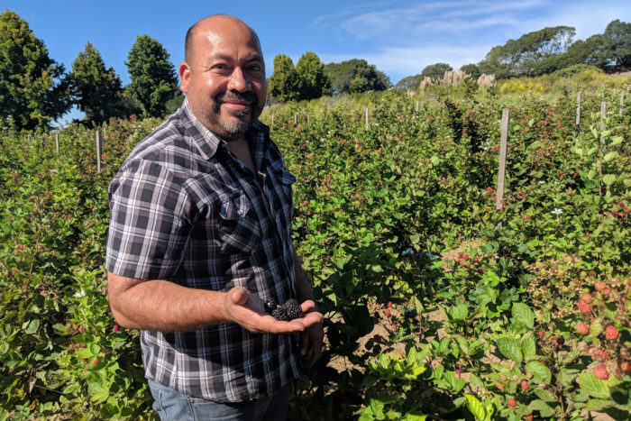 Latinx farmowner Javier Zamora on his farm