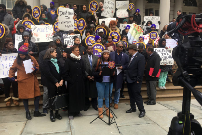 "Princess Wright (center), a worker at a Brooklyn McDonald's, speaks on Feb. 13, 2019, next to New York City Council Member Adrienne Adams, who sponsored one of the two ""Just Cause"" bills."