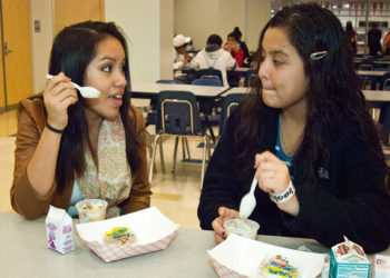 Students at Washington-Lee High School in Arlington, Virginia enjoy breakfast at school as part of the federally assisted National School Breakfast and National School Lunch Programs. (USDA photo by Bob Nichols)