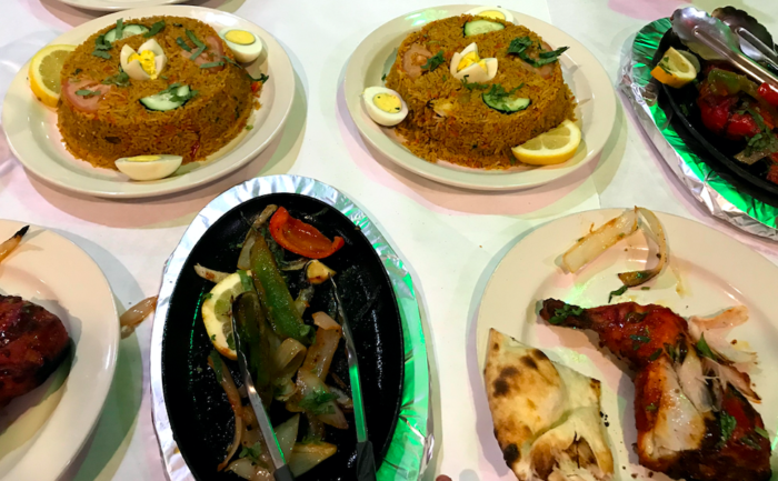 A table spread with food at Bismillah