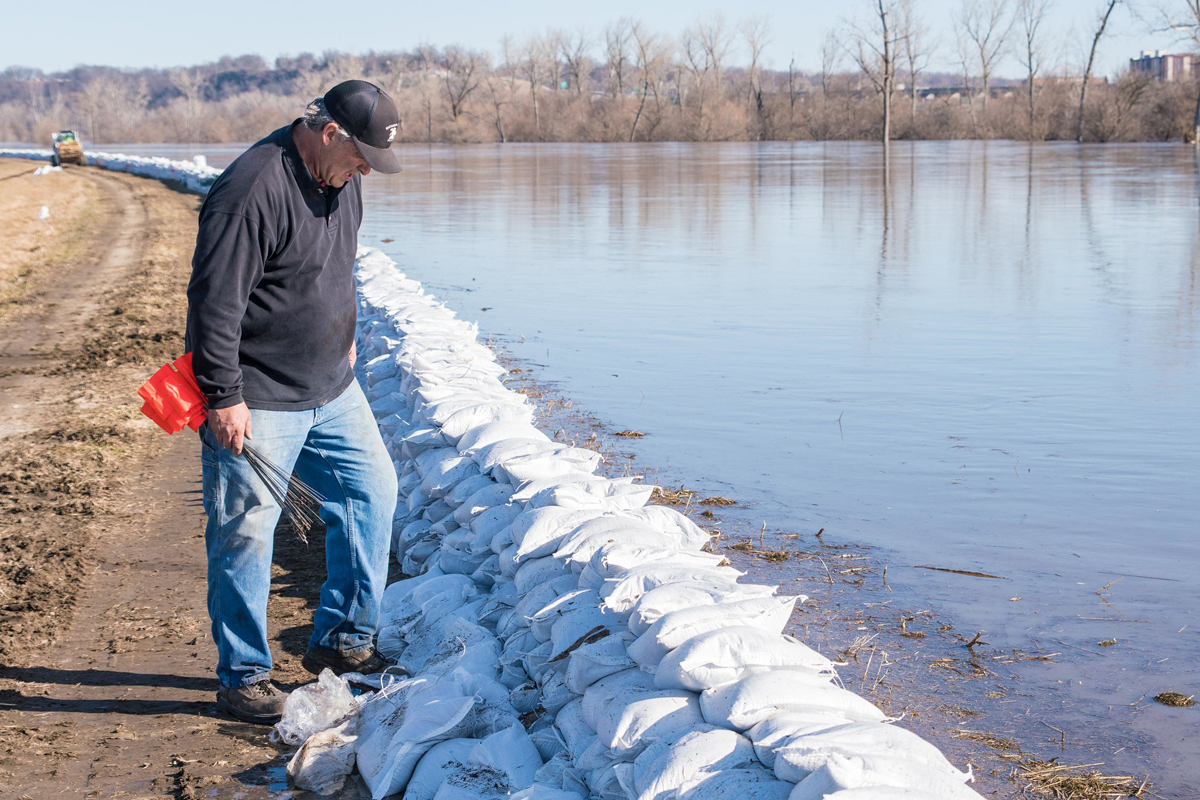 Ron Hook, western district commissioner or Buchanan County, inspects the levee in Elwood, Kansas, March 22, 2019. (U.S. Air National Guard photo by Tech. Sgt. Patrick Evenson)