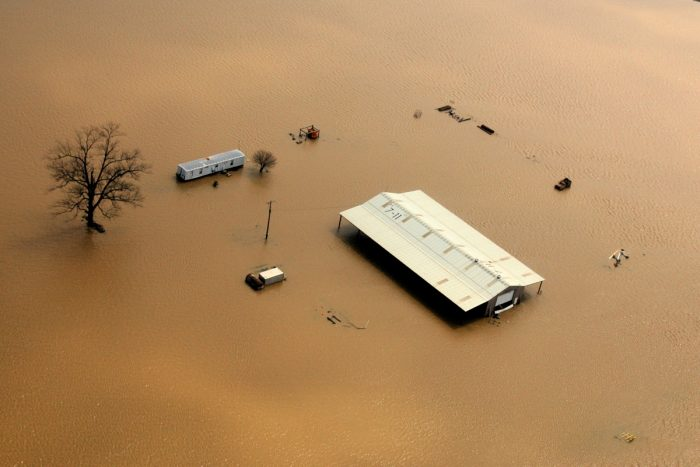 Farm buildings isolated by flood waters after Arkansas' Black River flooded following torrential rains. (FEMA photo by Samir Valeja)