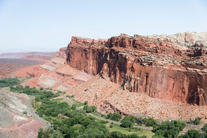 A view of the Waterpocket Fold and Fruita's Orchards, seen from the Cohab Canyon trail in Capitol Reef National Park. The Waterpocket Fold, a geologic feature that runs through southeastern Utah, is characterized by the significant drop in elevation from its west face (shown above) to the east face. An interest in the Fold and its surrounding natural arches initially spurred President Franklin Delano Roosevelt to designate 37,711 acres as Capitol Reef National Monument in 1937. The Monument had expanded to cover 254,251 acres when President Richard Nixon signed the bill to create Capitol Reef National Park in its place in 1971.