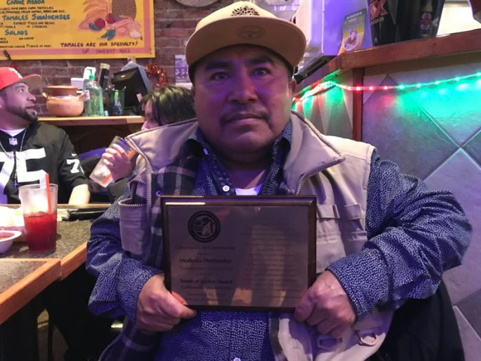 Modesto Hernandez, receiving a 2018 Seeds of Justice Award from from C2C. (Photo courtesy of C2C)