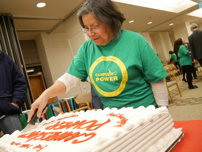 "Rosalinda Guillen cutting a ""Campesino Power"" cake during a C2C Farmworker Tribunal. (Photo courtesy of C2C)"